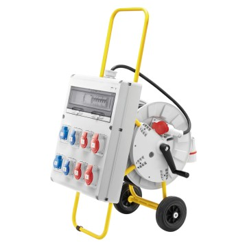 Protected board equipped with cable and mobile plug, with yellow painted accident prevention metal conduit carriage with two wheels and rotary drum for rewinding and storing the cable - IP44